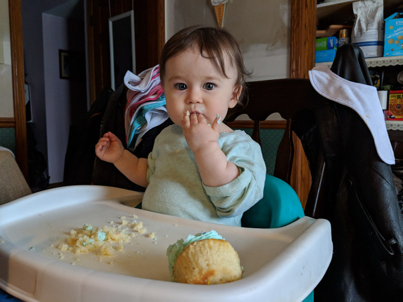 baby-eating-cupcake-birthday-one-year