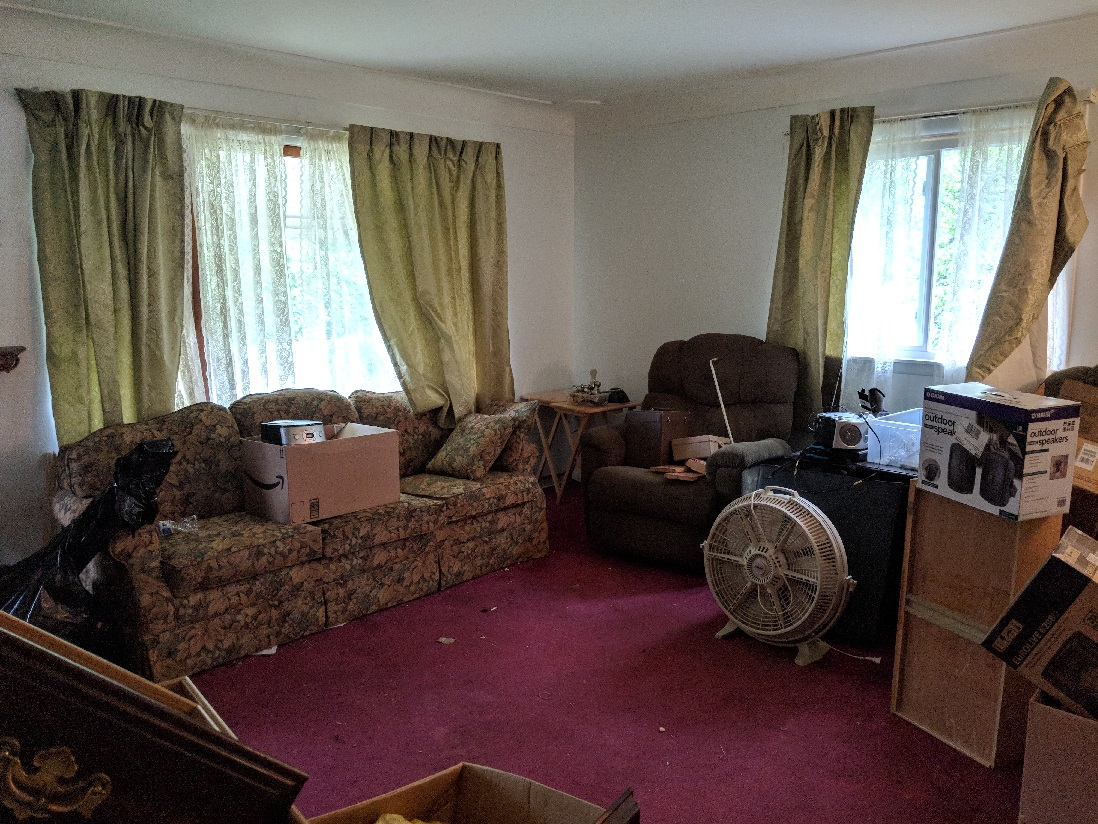 messy-living-room-foreclosure-home
